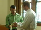 Keith Kettner helps Paul Gaschler get ready for the processional