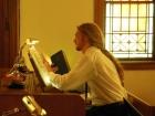 Organist James Clausen prepares for worship